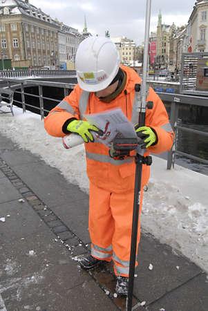 ediroial: Copenhagen  Denmark_Polish immigrant enginneer worker marking ground arround Copenhagen city from CMT construction site 11 Dec. 2012