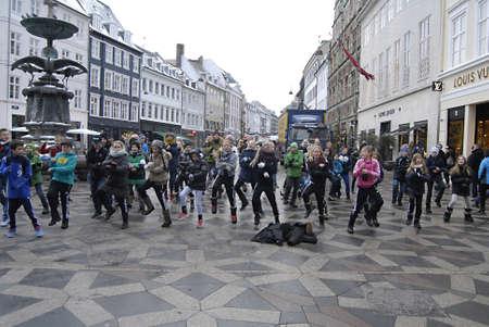 ediroial: Copenhagen  Denmark.  School students from Fuglsanggardsskolen dancing with music entertain people and show how to healkth fitness on stroeget Amager torv  14 Dec. 2012          Editorial