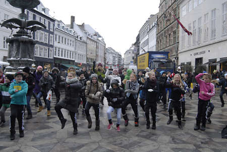 educations: Copenhagen  Denmark.  School students from Fuglsanggardsskolen dancing with music entertain people and show how to healkth fitness on stroeget Amager torv  14 Dec. 2012        Editorial
