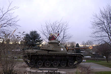 idaho state: LEWISTONIDAHO STATEUSA _ Idaho state veteran home democrate army tank with christmas snata and christmas lights and infron of home 18 Dec. 2012      Editorial