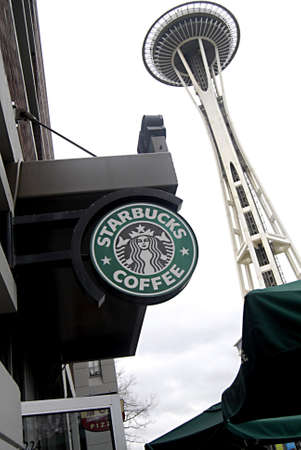 SEATTLEWASHINGTON STATE USA _  Starbucks cafe and view of Space needle 26 Dec. 2012