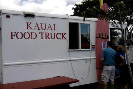 KAUAI ISLAND  HAWAII USA _Vacationers enjoying local food at Kauai Food Truck at Koloa city at theis samous site of sugar cane planattion and guess this only Food truck in Hawaii 12 Jan 2013