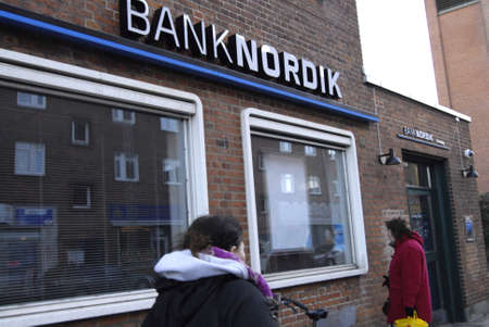 fale: Copenhagen  Denmark. Mostly all big danish banks closed their bank local branches and make other mponey cash less banks where no money to cash or depoosit in Denmark among banks are danske bank,nordickbank nordea people ashing money from money automate a Editorial