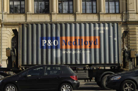 contain: Copenhagen  Denmark.   P&O Needlloyd contain lorry on road  at kongen nytorv and the royal thetaer at backgroud 5 March 2013