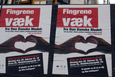 strong message: Copenhagen  Denmark. Demontsration poster with strong message Hands off from danish model trade union  at D