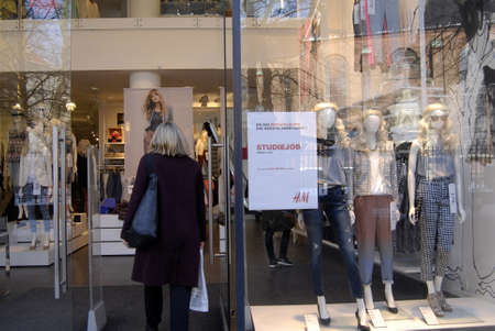 hm: Copenhagen  Denmark. Banner read that H&M hire for student job under 18 years age 14 March 2013          Editorial