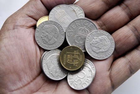 Korn: KASTRUPCOPENHAGENDENMARK _ Swedish coins swedish korn as Swedes are not with Eurozone  like Denmark and England Swedish coins on hands and not on hand palm 19 March 2013         Editorial
