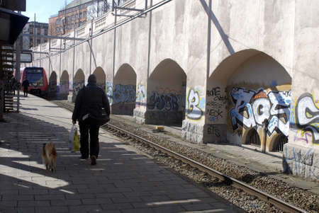 tog: Copenhagen  Denmark.(?terport togstationen)Osterport train station is graffiti arts show case every stone and brick is painted with graffiti painting or arts some call it arts and other called vandlizing  these graffiti artists or painter come in darks a
