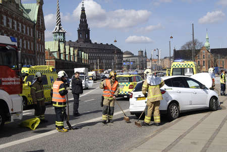 fire fighter: Copenhagen  Denmark._Police talks to eye witness car accident at Knippelsbro today on noon where amubalnce drives away man injurd  fra europcar rental   where medicare ambulance and police and fire fighter work together to clear car accident at Knippelsb Editorial