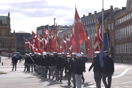 Copenhagen / Denmark. _Danish marins (Navels)union celebrats 100years jublie  therefore senior navel officers march with danish flags  at Christiansborg grand sq today on saturday 27 April 2013