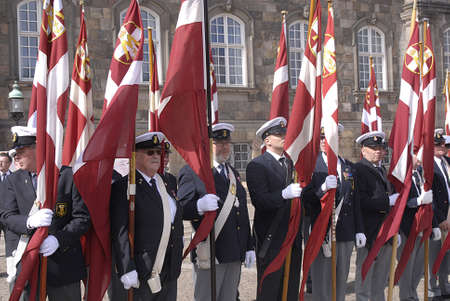Copenhagen / Denmark. _Danish marins (Navels)union celebrats 100years jublie  therefore senior navel officers march with danish flags  at Christiansborg grand sq today on saturday 27 April 2013       Editoriali
