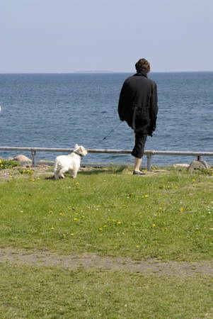 sund: KASTRUPCOPENHAGENDENMARK _ Danish woman look over sund sea Sweden  from Amager side of sea 12 May 2013         Editorial