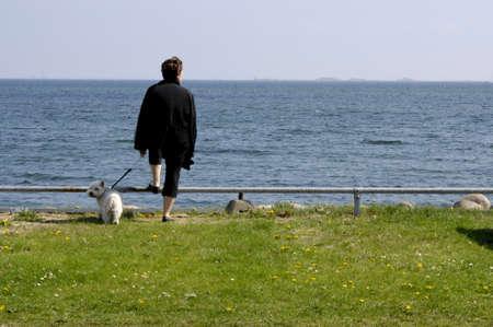 sund: KASTRUPCOPENHAGENDENMARK _ Danish woman look over sund sea Sweden  from Amager side of sea 12 May 2013