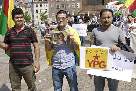 syria peace: Copenhagen  Denmark._Handful, kURDS (khurds) living in Copenhagen staged protest rally with Kurds flags and banners and photo PKK kurd leader in prision for peace full outcome of syria and Tukey and Ir an kurds from all these three countries demontrated
