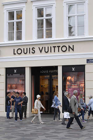louis vuitton: Copenhagen  Denmark. _Consumers and travelers in and out of Louis Vuitton store on stroeget today on 25 June 2015