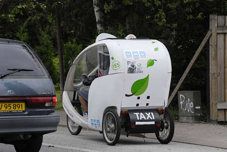 KASTRUPCOPENHAGENDENMARK _  Bike taxi or cycle taxi or pedicabe or asian name rickshaw use for mini journey 27 June 2013 27 June 2013       Editorial