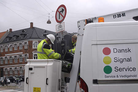 trafic: Copenhagen  Denmark. _Electrician working on to cgange new trafic light signal today on 30 June 2013