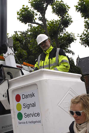trafic: Copenhagen  Denmark. _Electrician working on to cgange new trafic light signal today on 30 June 2013         Editorial