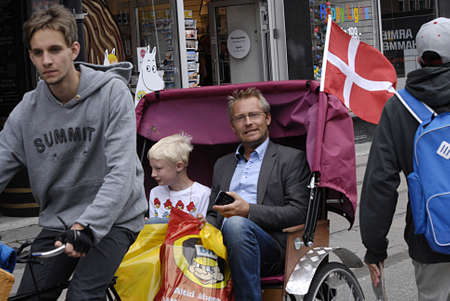 Copenhagen  Denmark. _Tourists in  Bicycle taxi or bike taxi or pedicabe or rickshaw 3 July 2013