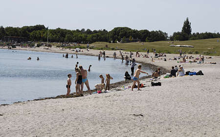 sun bathers: KASTRUPCOPENHAGENDENMARK _ Sun bathers at Amamager strand park beach  today on warm summeer day 8 July 2013