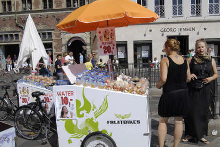 Copenhagen  Denmark.   Three females fruit vandors most of young females work as vandors are from former eastern european countires 18 July 2013