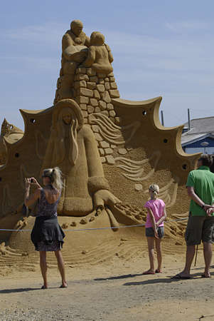 eldlery: Hundested  Denmark. Northe Sealand town Hundested Sand Sculptures festival and travelers and tourism and habour life ferie ship and local train daily shguttle for Hundested Habour  today on 18 July 2013