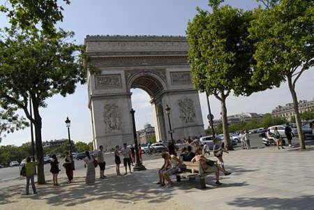 taking nap: PARISFRANCE  _travelers  enjoy hoet Paris weather and Visitors taking nap in veery hot 30c on Avenue des champs elysees near Arch de Triophme 22  JULY 2013