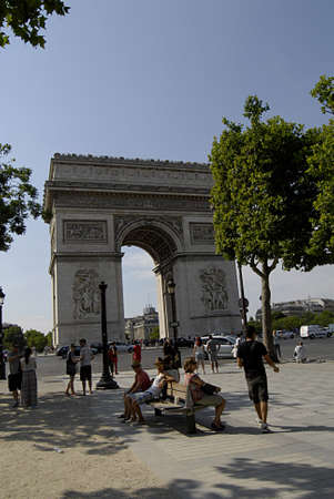 PARISFRANCE  _travelers  enjoy hoet Paris weather and Visitors taking nap in veery hot 30c on Avenue des champs elysees near Arch de Triophme 22  JULY 2013