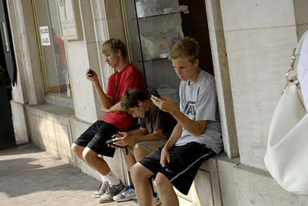 PARIS/FRANCE_Future generation use mordern technology  like  Iphone and smartphone to comunicate with  their world  24 July 2015      Stock Photo - 21100277