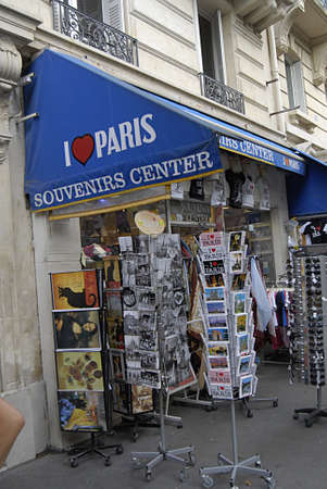 PARISFRANCE _Tourtists pass by I love paris souvenirs center near Notre dame cathedral 23 July 2013