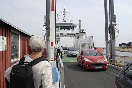 cheapest: HOLBAECK  Denmark._Holbeak habour and travel life on small ferry from Holbeak to Oro or Ordoe (Or�) farry  travelers are comming and going to Ore small island 30 mintues from Holbeak city and cheapest way to visit Oro  Island from main land 3 August 2013 Editorial