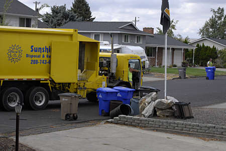 sunshine state: LEWISTONIDAHO STATE USA _6 sept.2013 Male workers from Sunshine dispocal and recycle copmpany working on disposal and recycle day  in Valley      (PHOTO BY Francis Dean  Deanpictures