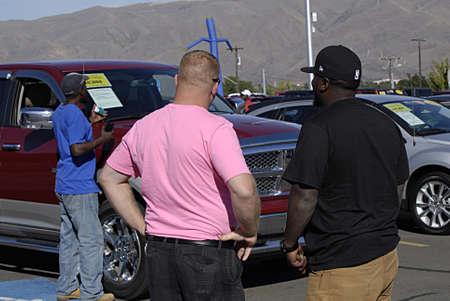 tage: LEWISTONIDAHO STATE USA _   Car consumer looking at price tage at car display at mall 20 sept. 2013      Editorial