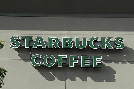 polictics: CLARKSTONWASHINGTON STATE USA _   Female consumer paid 2� and  5$ for startbuck coffee store and some paying 2$ uptill 5$ bucks us dollars for coffe and other drink items  store 23 sept. 2013     Editorial