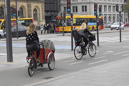 transportaion: Copenhagen  Denmark.  14 October 2013_ Danish bicylists transport their family by bikes 15 Oct. 2013