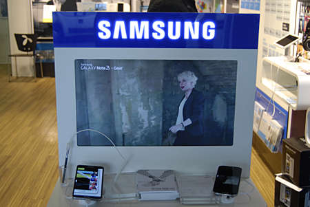 Copenhagen / Denmark.  22 October 2013_Consumer inspects samsung products at telecom store      Stock Photo - 23003817