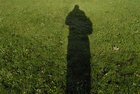 Kastrup /Denmark-  06 November  2013 _Male shadow on grass      Stock Photo - 23834426