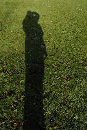 Kastrup /Denmark-  06 November  2013 _Male shadow on grass Stock Photo - 23834429