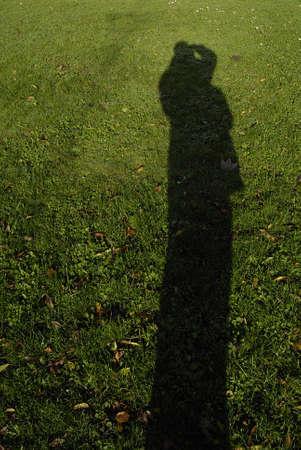 Kastrup /Denmark-  06 November  2013 _Male shadow on grass Stock Photo - 23834430