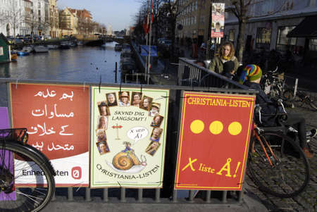 councils: Copenhagen Denmark-  08 November  2013  Local politican for city councils immigrant background use their back home language spread their message with foreign language elections posters and in denmark it is now eoections poster vandalism culture  no one i Editorial