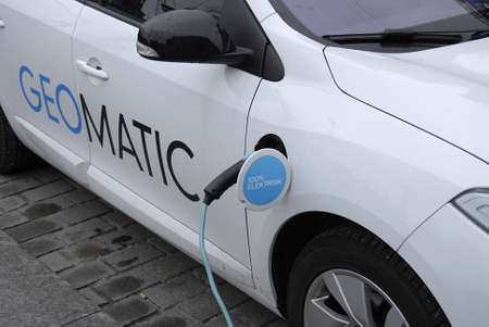 recharge: Copenhagen Denmark-  18 November  2013 _ electric car at recharge station geomatic at infrom copenhagen city hall townhall sq.