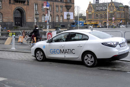 recharge: Copenhagen Denmark-  18 November  2013 _ electric car at recharge station geomatic at infrom copenhagen city hall townhall sq.             Editorial