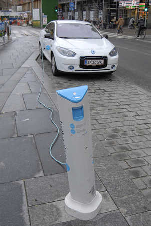 Copenhagen /Denmark-  18 November  2013 _ electric car at recharge station geomatic at infrom copenhagen city hall townhall sq.          Stock Photo - 23817411