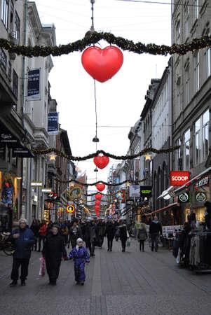 Copenhagen /Denmark-  18 November  2013     Christmas shopper under christmas light decoration onstroget         Stock Photo - 23817420