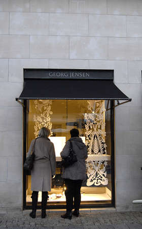 Copenhagen /Denmark-  18 November  2013  Female consumeer window shopper at Georg Jensen on stroget             Stock Photo - 23817421