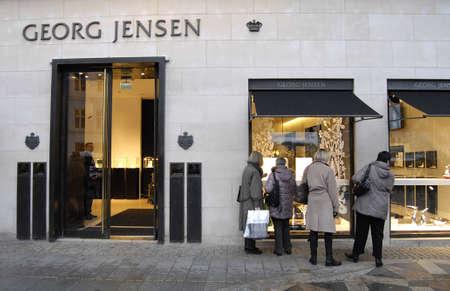 Copenhagen /Denmark-  18 November  2013  Female consumeer window shopper at Georg Jensen on stroget           Stock Photo - 23817422