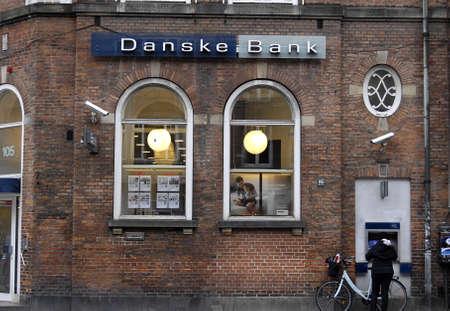 cashing: Copenhagen Denmark-  19 November  2013   Female cashing money at atm danske bank