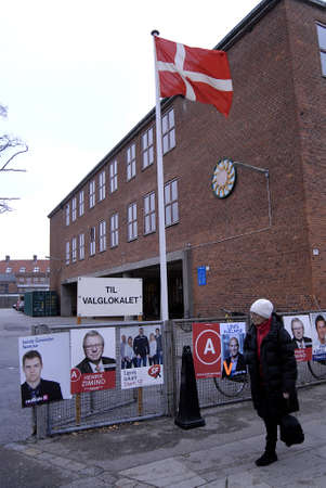 councils: Kastrup Denmark-  19 November  2013  _Danes rushing to polling station to cast thier votes for city councils and counties region at thier slected polling stations most of polish stations are locat in schools here this polling station is on Amager island  Editorial