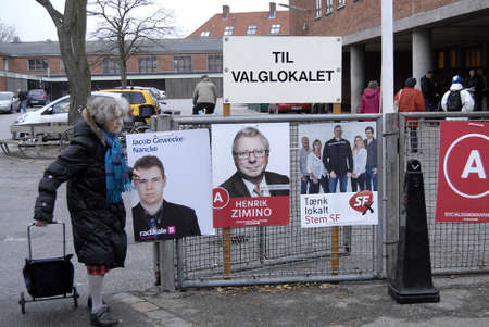 Kastrup /Denmark-  19 November  2013  _Danes rushing to polling station to cast thier votes for city councils and counties region at thier slected polling stations most of polish stations are locat in schools here this polling station is on Amager island  Stock Photo - 23817764