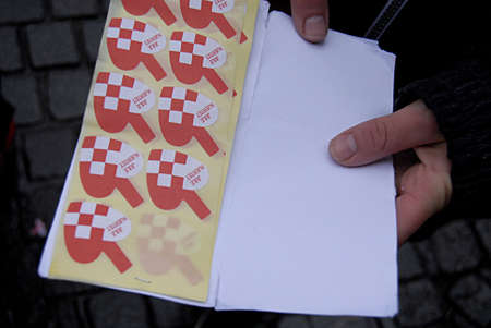 eldlery: Copenhagen Denmark- 04  December   2013  _   Eldlery man buying  christmas hearts from children office sticker for 2 dkr b�rnenes konto 2kr